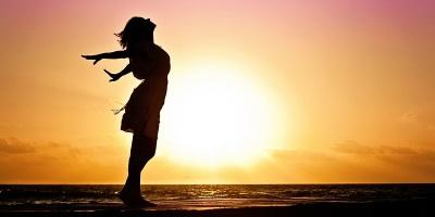 Grateful happy woman silhouette